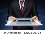 business man with tablet on... | Shutterstock . vector #1202165725