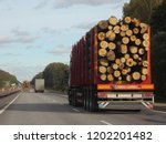 heavy trucks transports logs on ... | Shutterstock . vector #1202201482