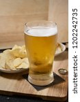 light lager in a glass misted... | Shutterstock . vector #1202242735