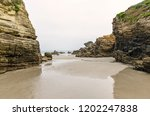 rock formations on the beach of ... | Shutterstock . vector #1202247838