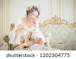 greyhead woman in rococo dress... | Shutterstock . vector #1202304775