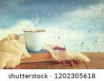 romantic scene of cup of coffee ... | Shutterstock . vector #1202305618