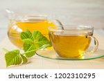 herbal tea served with fresh... | Shutterstock . vector #1202310295
