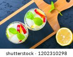 cocktails with fresh fruits and ... | Shutterstock . vector #1202310298