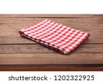 kitchen towel on empty wooden... | Shutterstock . vector #1202322925