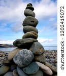 tall stone and pebble tower... | Shutterstock . vector #1202419072