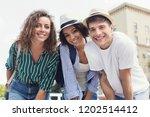 group of happy multiracial...   Shutterstock . vector #1202514412