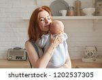 happy motherhood  youth ... | Shutterstock . vector #1202537305