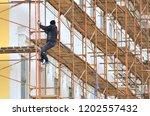 building facade restoration... | Shutterstock . vector #1202557432