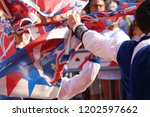 competitions of the flag wavers ... | Shutterstock . vector #1202597662