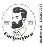 barbershop. handsome man with a ... | Shutterstock .eps vector #1202610265