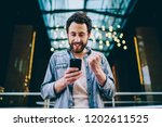 excited bearded young man... | Shutterstock . vector #1202611525