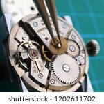close up of watchmaker... | Shutterstock . vector #1202611702