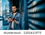 portrait of handsome bearded... | Shutterstock . vector #1202611975