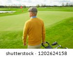 back view of casual senior man... | Shutterstock . vector #1202624158