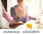 waitress holding electronic... | Shutterstock . vector #1202628055