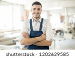 young successful worker in... | Shutterstock . vector #1202629585