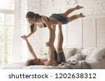 loving young couple having acro ... | Shutterstock . vector #1202638312