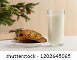 milk and cookies for santa... | Shutterstock . vector #1202645065