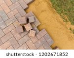 block paving being laid on top... | Shutterstock . vector #1202671852