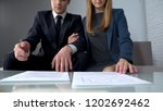 business couple signing... | Shutterstock . vector #1202692462