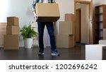 man holding cardboard box ... | Shutterstock . vector #1202696242