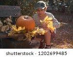 young european boy in stripy... | Shutterstock . vector #1202699485