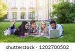 multi ethnic students lying on... | Shutterstock . vector #1202700502