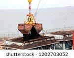 cargo terminal for discharging...   Shutterstock . vector #1202703052