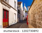 cozy old street and sacre coeur ... | Shutterstock . vector #1202730892
