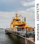 a yellow ferry parked in a dock ...   Shutterstock . vector #1202751778