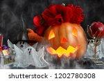 happy halloween pumpkin head in ... | Shutterstock . vector #1202780308