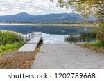 the ramp to the dock on...   Shutterstock . vector #1202789668