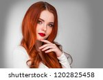 photoshot of gorgeous redhead... | Shutterstock . vector #1202825458