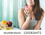woman cheating during diet and...   Shutterstock . vector #1202826472