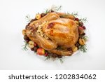 garnished roasted turkey with... | Shutterstock . vector #1202834062
