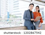 young business man and woman... | Shutterstock . vector #1202867542