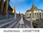 woman tourist is enjoy... | Shutterstock . vector #1202877358