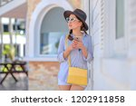 pretty young woman with wear... | Shutterstock . vector #1202911858