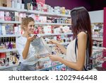 positive female seller giving... | Shutterstock . vector #1202946448