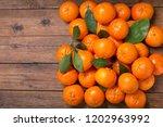 fresh mandarin oranges fruit or ... | Shutterstock . vector #1202963992