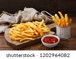 french fries with ketchup on... | Shutterstock . vector #1202964082