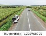woman stuck with broken car in... | Shutterstock . vector #1202968702