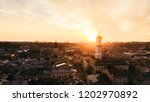 aerial view of sunset above... | Shutterstock . vector #1202970892