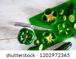 knife with vegetables on... | Shutterstock . vector #1202972365