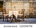Table And Chairs In Front Of...