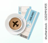 air ticket and a cup of coffee... | Shutterstock .eps vector #1202991955