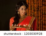 portrait of a woman holding a...   Shutterstock . vector #1203030928