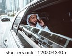 arabic businessman looking at...   Shutterstock . vector #1203043405