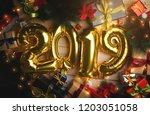 2019 golden balloon between... | Shutterstock . vector #1203051058